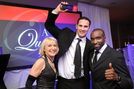 656219-4 : ©Lionel Heap : News : A Question of Brains Charity Event in Aid of Steps : Winner 2012.... A Question of Brains winner representing his table Leicester Tigers star Craig Newby (centre) collects the trophy from event organiser and Steps patron Rosemary Conley (left) & special guest freerunning founder Sebastian Foucan (right).