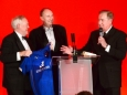 656410-05 : @Lionel Heap : News : A Question of Brains 2015 Charity Dinner in AId of Steps Conductive Education Centre in Shepshed : Auction... local sporting legends (from left) Peter Wheeler, Jonathan Agnew and Alan Birchenall auction a signed Leicester City shirt which helped towards raising £75,000 for Steps.