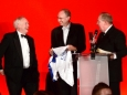 656410-07 : @Lionel Heap : News : A Question of Brains 2015 Charity Dinner in AId of Steps Conductive Education Centre in Shepshed : Auction... local sporting legends (from left) Peter Wheeler, Jonathan Agnew and Alan Birchenall auction a signed Jamie Vardy Leicester City shirt which helped towards raising £75,000 for Steps.