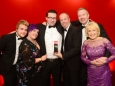 656410-03 : @Lionel Heap : News : A Question of Brains 2015 Charity Dinner in AId of Steps Conductive Education Centre in Shepshed : 2015 A Question of Brains Champions, The Healy Group L-R Sam Beales, Laura Beales, Gareth Healy, Mark Powell, Anthony Healy and Steps patron Rosemary Conley. The event raied £75,000 for Steps.