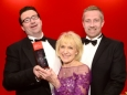 656410-04 : @Lionel Heap : News : A Question of Brains 2015 Charity Dinner in AId of Steps Conductive Education Centre in Shepshed : 2015 A Question of Brains Champions, The Healy Group L-R Collecting the trophy from Steps patron Rosemary Conley are team captains Gareth Healy (left) and Anthony Healy (right). The event raised £75,000 for Steps.